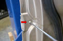 Both door moldings are held in place by a series of friction clips and a single T20 Torx screw.