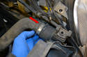 Remove the upper radiator to coolant pump hose.