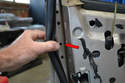 To remove the lock section you first pull back the weather strip on the inside of the door level with the handle, revealing the access holes (red arrow).