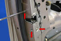 Use a T30 Torx and remove the three Torx screws (red arrows) holding the lock to the door frame.