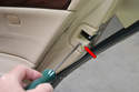 Remove the door lock piece by unscrewing the single T20 Torx head screw (red arrow) and pulling the trim piece straight back.