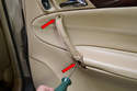 With the handle off use your T27 Torx and remove the 2 screws inside the handle (red arrows) securing it to the door.