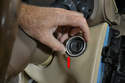Next remove the bezel or trim (red arrow) surround around the ignition switch.