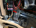 Next remove the parking brake cable (red arrow) from its holder and the dash is free to be removed from the car.