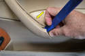 Use your trim removal tool and gently pry the cover of the pull handle (yellow arrow).