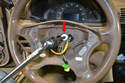 With the airbag removed you can see the 10mm Allen screw (red arrow) that holds the wheel on.