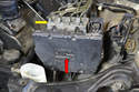 The control module is located on the front of the ABS unit (red arrow).