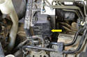 Located on the left side of the unit is the main brake wiring harness (yellow arrow).