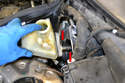 Pull the master cylinder straight forward off the brake booster, then tilt it slightly sideways and remove it from the car.