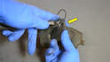 Use a flathead screw driver to carefully push out the old sensor (yellow arrow) if you plan to re-use it.
