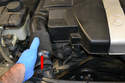 Remove each duct by compressing them towards the engine (red arrow) and slipping them off the air inlet.