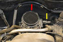 With the air filter covers off you can see the MAF sensor housing at the rear of the engine (red arrow) along with the harness (yellow arrow).
