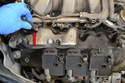 The right side hose connects to the top of the right side valve cover (red arrow).
