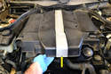 With the ducts off remove the front engine cover.