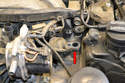 Use caution when removing them as there is a metal extension that goes down into the manifold (red arrow) and it can get stuck with age.