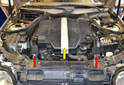 You will need to remove the two air inlet ducts (red arrows) as well as the front engine cover (yellow arrow) to get access to the air filter housing on top of the engine.