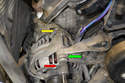 Use an E14 Torx (red arrow) and remove the two bolts.