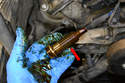 The tensioner has almost 2 inches of threads on it (red arrow) so just keep unscrewing until it comes out.
