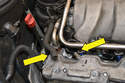 Remove the line from the valve cover on the passenger side.