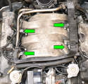 Using an E10 female Torx you can now remove the four Torx bolts holding the fuel rail and injectors to the intake manifold (green arrows).
