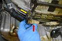 Remove the rear sensor connectors (red arrow) and the wires from their clips (yellow arrow).