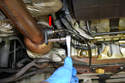 For the post cat or rear sensor use a 22mm wrench and simply remove the rear sensor from the exhaust pipe.