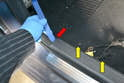 Front Sills- The sill plate sits in a plastic slot in the lower A-pillar trim (red arrow).