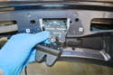 Pry the plastic cover off of the latch and push the latch up into the trunk lid.