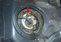 The fuel pressure sensor is located in the lid of the fuel filter and can be replaced without removing the retaining ring or pump (red arrow).