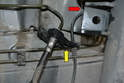 Front- Disconnect the cable from the holder on the brake lines (yellow arrow) and where it connects to the inner fender (red arrow).