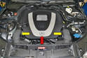 You need to remove the front engine cover (red arrow) and the air ducts (yellow arrows) to replace the coolant hoses so please see our article on engine cover removal for additional assistance.