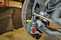 Remove the tie rod by inserting a T30 Torx in the top of the tie rod stud (yellow arrow) and then use a 21mm wrench to remove the nut (red arrow).