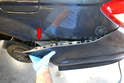 Use a trim removal tool and starting at the fender, separate the cover from the body (red arrow).