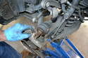 Use care as once the carrier comes off the axle it will be free and it is heavy but still attached to the thrust arm.