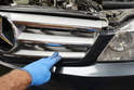 Use light hand pressure and push the bottom of the grille back in towards the radiator.