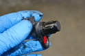 If you are removing the sensor to perform other work and reinstalling it always replace the O-ring to prevent leaking oil (red arrow).