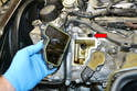 Pull the AOS off the valve cover and gently separate the hose from the top of the AOS (red arrow).