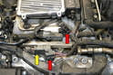 To remove the rail and injector begin by disconnecting the two wiring connections on the left side of the motor (red arrows) and slipping the harness of the fuel rail (yellow arrow).