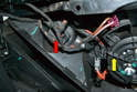 The blower motor resistor (red arrow) is located under the dash close to the tunnel and beside the blower motor (yellow arrow).