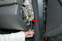 There is a single T20 Torx screw under the side of the dash (red arrow) that you need to remove.