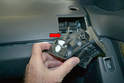 Side Vents - Once the clips on the vent release you can remove it with your hands and then turn it over and disconnect the wiring connection (red arrow).