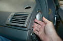 You can now reach your hand in behind and help guide the vent into place.