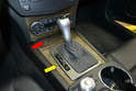To remove the ash tray (red arrow) you will first need to remove the shift knob and surround pieces (yellow arrow).