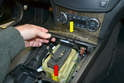 Close the ash tray lid (yellow arrow) and put the transmission into gear (red arrow).