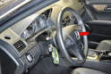 With the wheels centered lower the steering wheel to the midway point and move it as far forward as possible (red arrow).