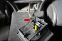 Lift the ashtray out and separate the wiring connection (red arrow) from the lighter (yellow arrow) by pulling it up.