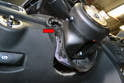 With the wheel and trim piece removed unclip the leather bag that connects the steering column tube module to the dash.
