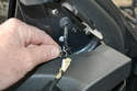 Remove the tab that holds the speaker wire and mirror wires to the door.