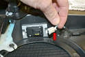 Disconnect the wiring by pressing in the small tab on the connection (red arrow) and pulling it out from the switch.
