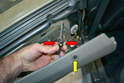 Lift the door panel up and out of the window channel starting at the rear and working your way forward.